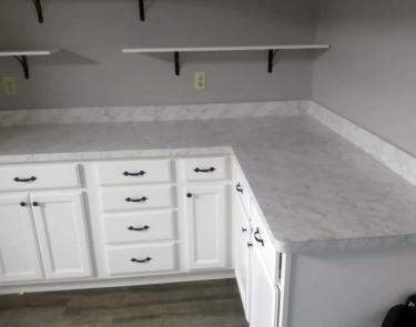 Laminate countertop and cabinets in laundry room