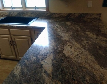 Residential kitchen laminate countertop installation over existing cabinets