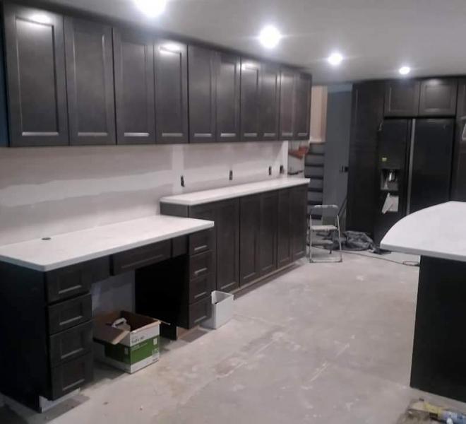 In-progress kitchen remodel with new cabinets, granite countertops prior to backsplash installation